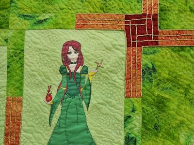 Closeup of Brigid and the pieced & embroidered Cross