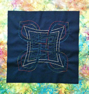 Scarlett's original Celtic design, Aine, stitched in variegated perle cotton thread.