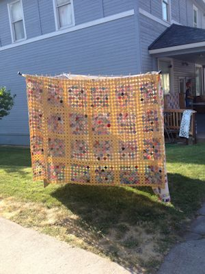 YoYo quilt on a quilt drying pole