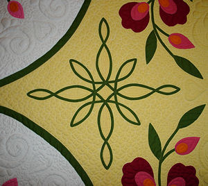 Close up of Elsie's quilt, showing the knotwork.