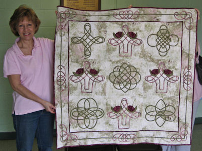 Jan Meadows with the Celtic quilt she won.